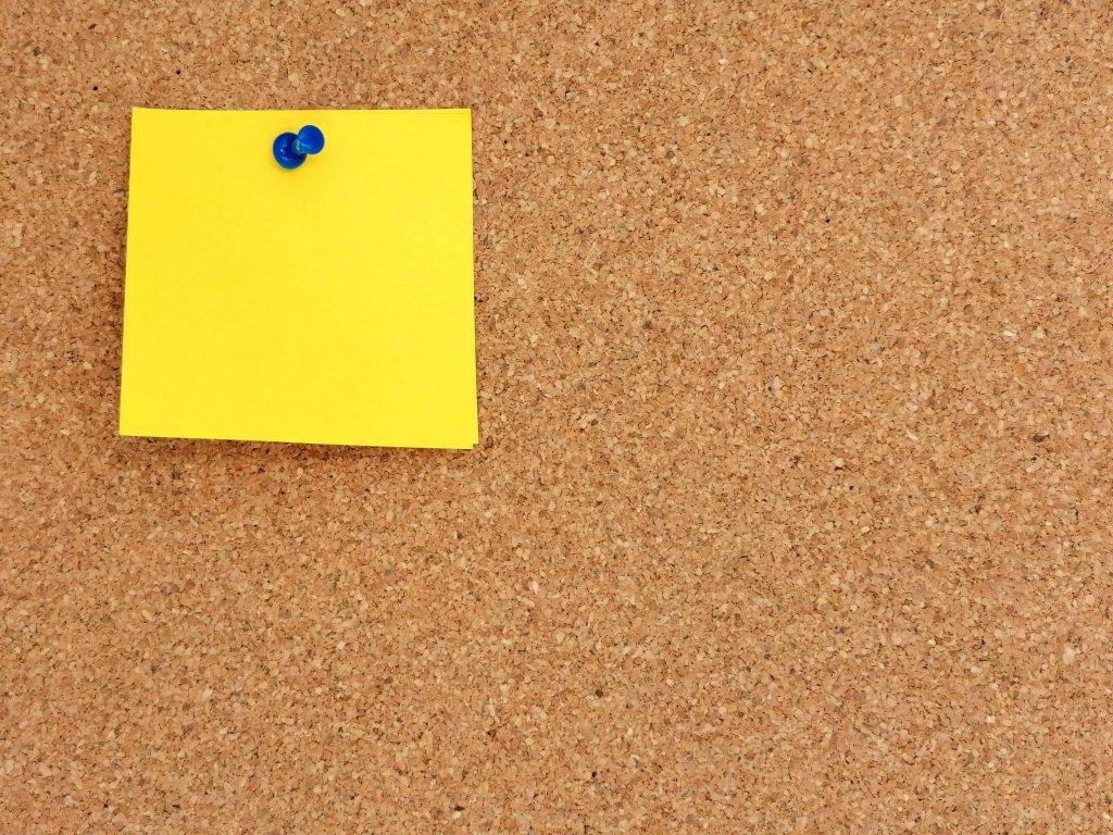 blank-post-it-note-on-pin-board-1.jpg